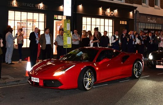 A Ferrari in front of the London Showroom Supercars 2016